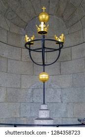 Traditional swedish golden Tre Kronor (Three Crowns) on spire - Swedish national emblem. Stockholm, Sweden.