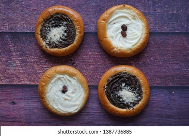 Traditional sweet czech bakery/pastry product: Yeast dough kolache  (kolace) with delicious poppy seeds filling and streusel topping, and cream quark cheese filling (tvaroh) kolache