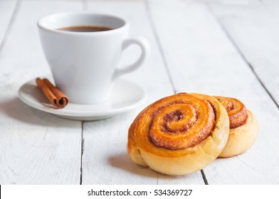 Traditional sweet homemade cinnamon rolls with coffee
