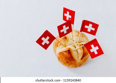 Traditional swiss bread buns called in German 1.Augustweggen baked in Switzerland to celebrate Swiss National Day on August 1st. The top of the bread being cut crosswise to shape a cross as swiss flag
