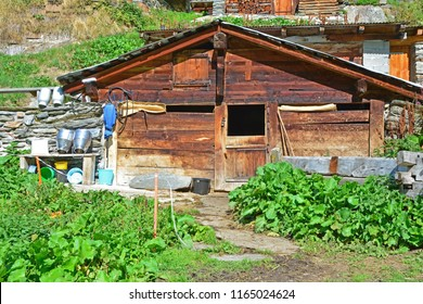 Traditional Swiss Mountain chalet farm in a mountain summer hamlet