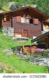 Traditional Swiss Mountain chalets in a mountain summer hamlet