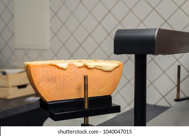 Traditional Swiss Raclette cheese on a Raclette machine