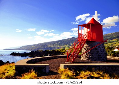 Traditional and symbolic red windmill at the coast of Pico island, Azores, Portugal