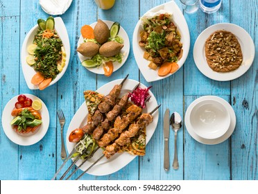 Traditional Syrian Cuisine, Grilled Kebab and Shish Taouk with Salads