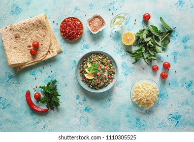 Traditional tabbouleh salad with ingredients to it on the kitchen table