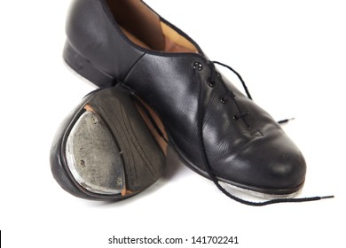 Traditional Tap dancing shoes on a white background and floor