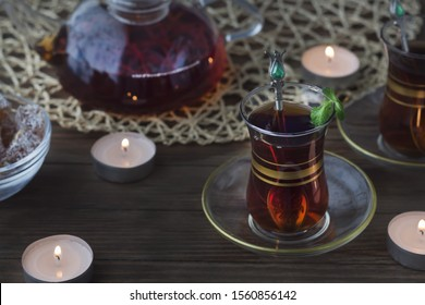 Traditional tea in Turkey. Turkish style Tea is served in a transparent cup, on a plate with a small teaspoon. Strong, black, tart tea. spa treatments, relaxation