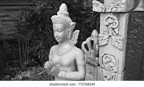 Traditional Thai angle statue to welcome people at entrance of garden. Black and white Statue texture.