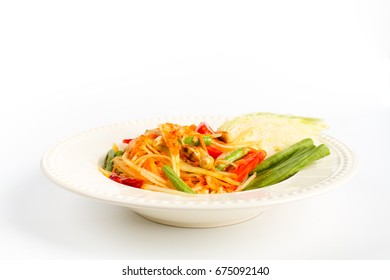 Traditional thai cuisine spicy green papaya salad on white background