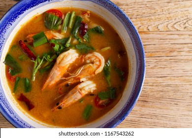 Traditional thai cuisine, Tom yum goong, Spicy shrimp soup on wooden background