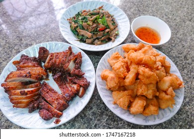 traditional Thai culture fried pork neck grilled intestines Chitterlings cuisine air fryer or moo tod ping yang box set street fast foods menu at thailand hot spicy sauces on wood sticky rice