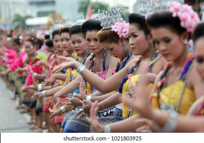 a traditional thai dance groupe at the parade on the Bun Bang Fai festival or Rocket Festival in Yasothon in Isan, notheast of Thailand. Thailand, Yasothon, Mai , 2013