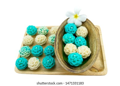 Traditional Thai dessert flower shape stuff with crush soybean and taro (Thai name kanom Chor phaka) in wooden basket on fabric sisal isolated on white background.Saved with clipping path.