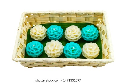 Traditional Thai dessert flower shape stuff with crush soybean and taro (Thai name kanom Chor phaka) in bamboo basket on fabric sisal isolated on white background.Saved with clipping path.