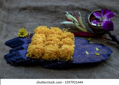 Traditional Thai desserts sweet and delicious : Golden egg strip is Thai desserts made from eggs on wooden background ( Thai name is Foi Thong).