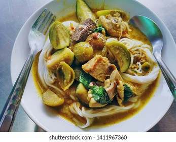 Traditional Thai Food. Rice Noodles with Green Curry Chicken.