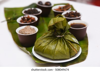 Traditional Thai  food sticky glutinous rice steamed/cooked, wrapped in banana leaf. Also a popular dish with spices star anise, clove, cinnamon in Kerala rice in banana leaf India.