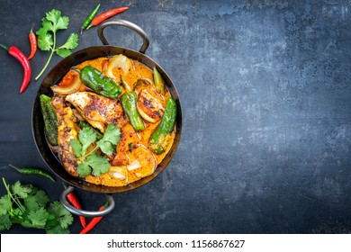 Traditional Thai kaeng massaman coconut chicken curry with jalapeno, poblano chili and sweet potatoes as closeup in a traditional bowl with copy space right