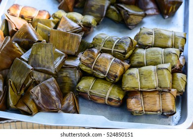 Traditional Thai and Lao food style, Sticky rice steamed in banana leaf ( Khao Tom Mat or Khao Tom Pad ) bananas and sticky rice inside.