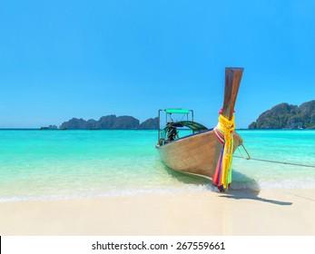 Traditional thai longtail boat at famous sunny Long Beach, Thailand, Koh Phi Phi Don, Krabi province, Andaman sea