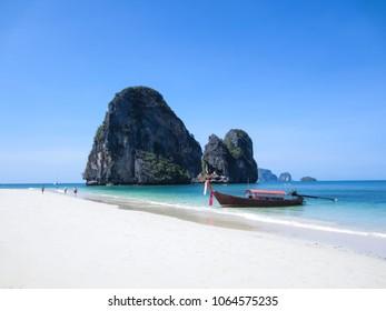 traditional thai longtail boat on railay beach  krabi thailand