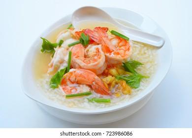 Traditional Thai porridge rice gruel and shrimp in bowl.