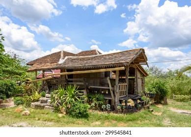 Traditional Thai rustic wooden house with porcelain roof, an uninhabited house exhibited in Na-or cultural village, Loei district, Thailand.