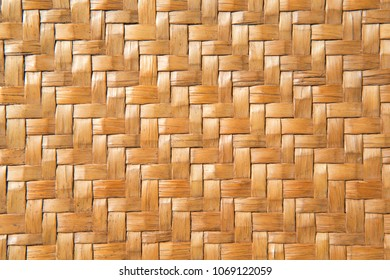 traditional thai style rattan pattern yellow color made from bamboo handcraft weave texture wicker surface for furniture material