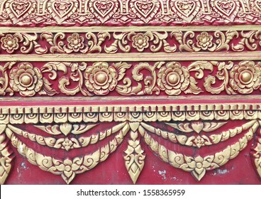 Traditional Thai style stucco on the wall of church in temple, Thailand.
