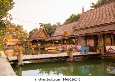 a traditional thai woodhouse with garden at the Maenam river in the city of  Phitsanulok in the north of Thailand.  Thailand, Phitsanulok, November, 2018.