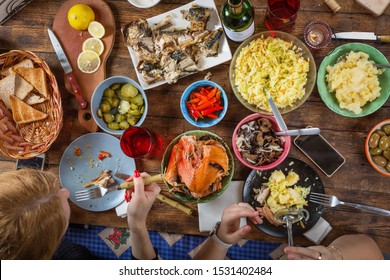Traditional Thanksgiving day celebration party. Flat-lay of family eating. Festive Christmas table, overhead view