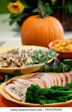 Traditional Thanksgiving Dinner With Side Dishes And Wine