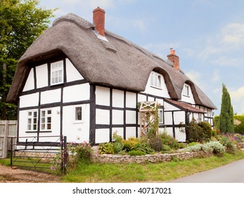 A traditional thatched cottage in an English village