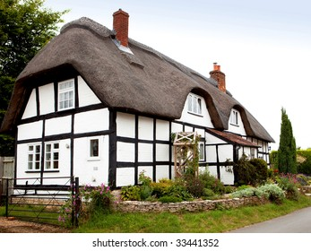 A traditional thatched cottage in rural England