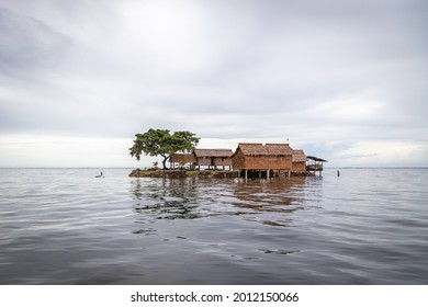 Traditional thatched house built on an artificial island in Lau Lagoon, on the eastern coast of Malaita Province in the Solomon Islands.