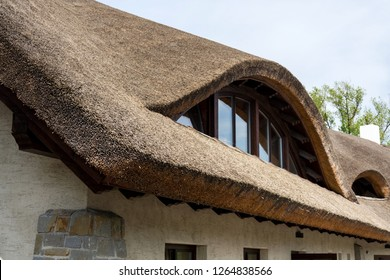 Traditional thatched roof from reed, sunny summer day