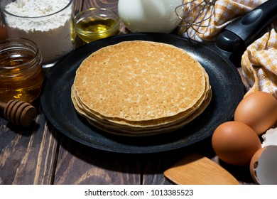 traditional thin pancakes in a frying pan, horizontal