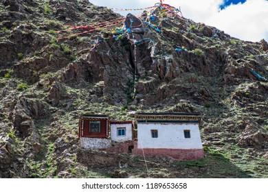 The traditional tibetan wooden house in the mountain of Eastern Tibet (Kham). Garze Tibetan Autonomous Prefecture, Sichuan, China.