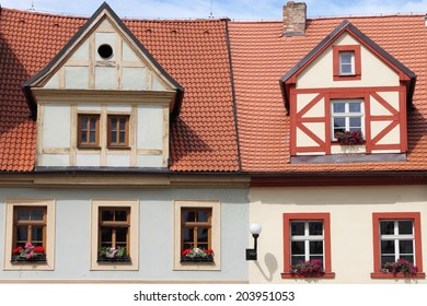 Traditional timbered house with red roof clay tiles
