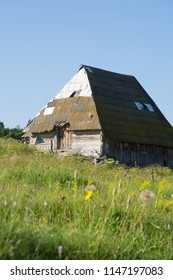 Traditional tin roofed barn surrounded by wild flower meadow, Zabljak, Montenergo, 2018