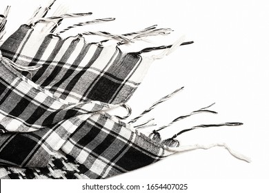 Traditional tissue black and white arabic man's head scarf Shemagh (Keffiyeh). Saudi men's national headdress called Ghutrah. Close up textile background.
