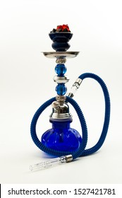 Traditional tobacco smoking and authentic flavour conceptual idea with blue arabian hookah or water pipe with black and red coal isolated on white background with clipping path cutout