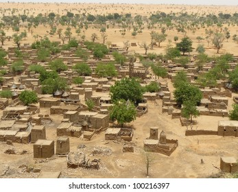 Traditional tribal village with flat-roofed mud dwellings and granaries in the West African nation of Mali.