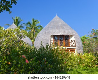 Traditional tropical hut in a garden