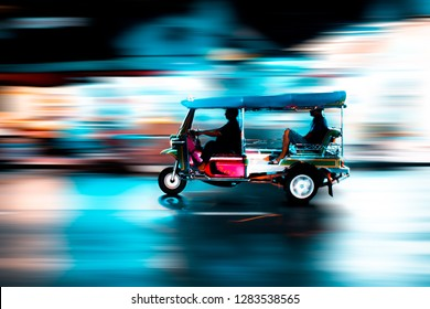 Traditional tuk-tuk from Bangkok, Thailand, at night in motion blur. This is a car that use to transport people for a long time and now this is a car that tourist should try when come to Thailand.