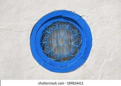 Traditional Tunisian window on white wall