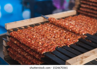 Traditional Turkish Adana Kebab or Kebap meat texture background with skewers in the turkish restaurant for dinner. Turkish cuisine food culture in Turkey.