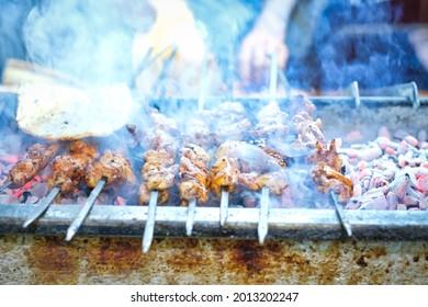 Traditional Turkish Adana Kebab and Adana Kebap. Kebab or kebap on metal skewer barbecue in the kebap restaurant.