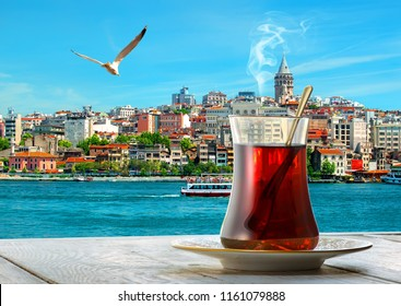 Traditional turkish apple tea on a background of cityscape